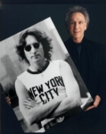 Bob Gruen with his photo of John Lennon